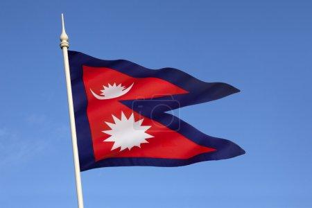 Foto de La bandera nacional de nepal es bandera nacional del mundo sólo no-cuadrilátero. hasta 1962, emblemas de la bandera, el sol y la luna, tenían rostros humanos. fueron removidos para modernizar la bandera. la bandera fue adoptada, con la formación de un nuevo - Imagen libre de derechos
