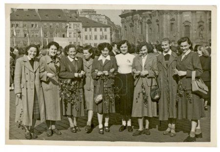 Group of young women in front of buildings