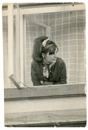 Partrait of an young woman - looking out the window (waiting for someone)