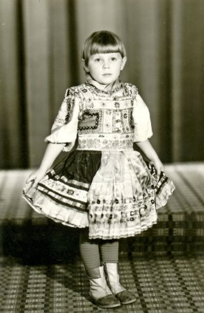 Child - girl with a decorated skirt (dress)