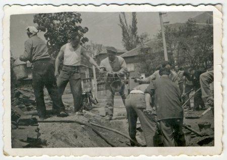 Men working in a village