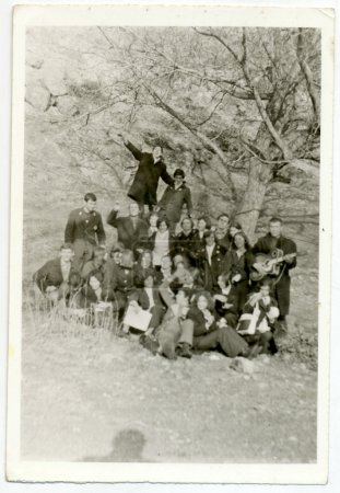 Photo for CENTRAL BULGARIA, BULGARIA, district Plovdiv - CIRCA 1970: Young people (some students) posing in an old tree (one plays the guitar) - Note: quite blurriness, better at smaller sizes - circa 1970 - Royalty Free Image