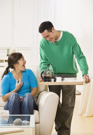 Happy Couple Having Coffee at Home