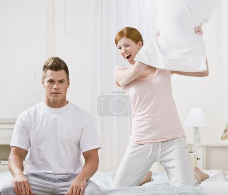Attractive Couple Playing Around with a Pillow Fight