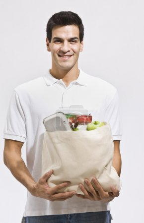 Attractive Man Holding Groceries