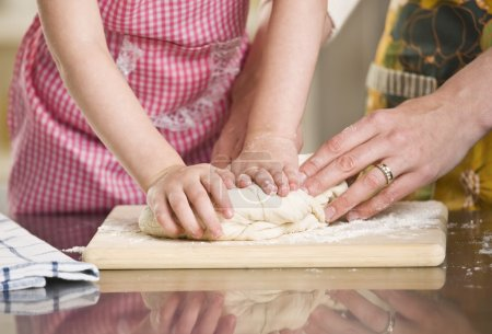 Woman and Child Kneading Dough
