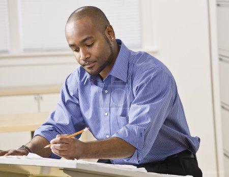 Man Working on Blueprints