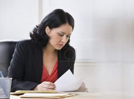 Woman Working on Paperwork