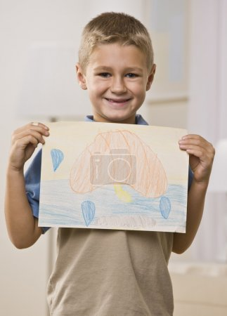 Boy Holding Picture
