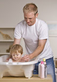 Father Giving Daughter Bath