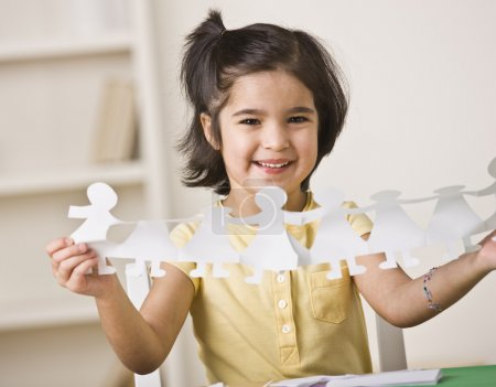 Girl Making Paper Dolls