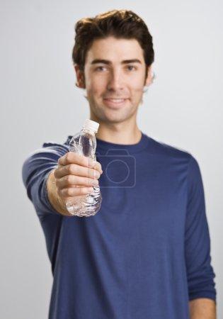 Man Crushing Water Bottle