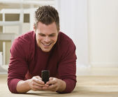 Attractive male with cell phone.
