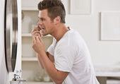 Man Flossing Teeth