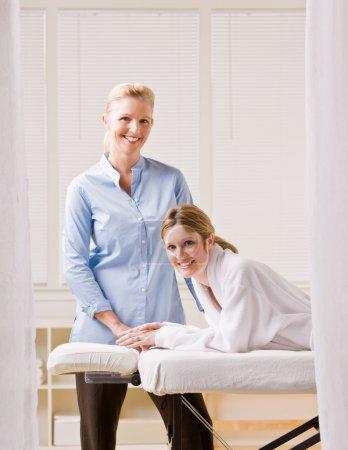 Woman and massage therapist