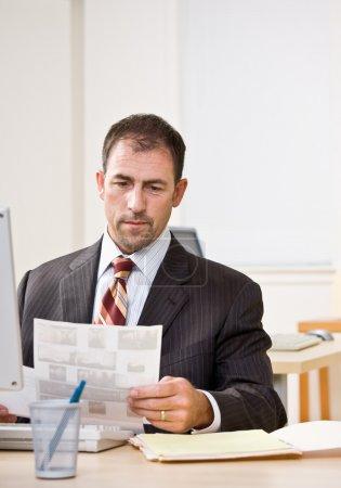 Businessman reviewing paperwork