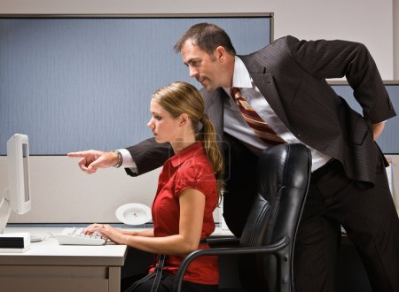 Businessman pointing at co-workers computer