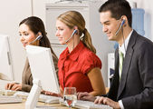 Business talking on headsets