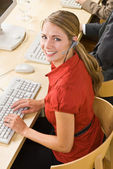 Businesswoman talking on headsets