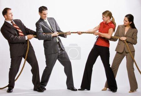 Business playing tug-of-war