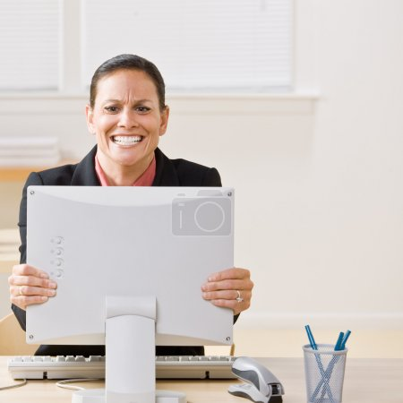 Businesswoman shaking monitor