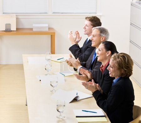 Business clapping in meeting