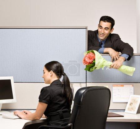 Businessman bringing co-worker flowers