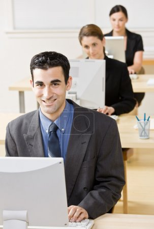 Business typing on computer