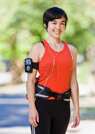 Woman wearing hip pack and mp3 player