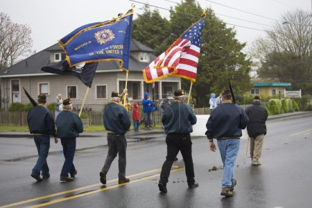 Photo for VFW Color Guard Marching on a Foggy, Wet Day - Royalty Free Image