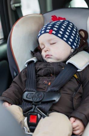 cute baby sleeping in car seat