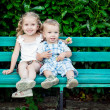 Funny little children brother and sister sitting o...