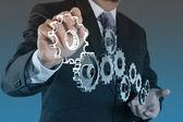 Businessman hand show gear to success