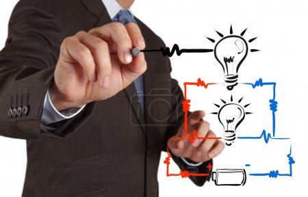 businessman hand draws electrical diagram