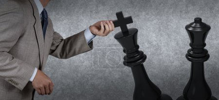 Businessman hand moving chess