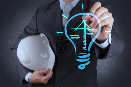 Photo for Engineer drawing lightbulb and construction as concept - Royalty Free Image