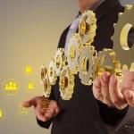 Businessman hand show 3d golden gear to success as...