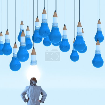 businessman looking at drawing idea pencil and light bulb concep