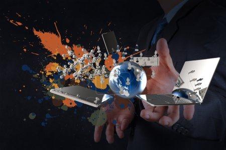 Photo pour Homme d'affaires montre la technologie moderne et éclabousser les couleurs comme concept - image libre de droit