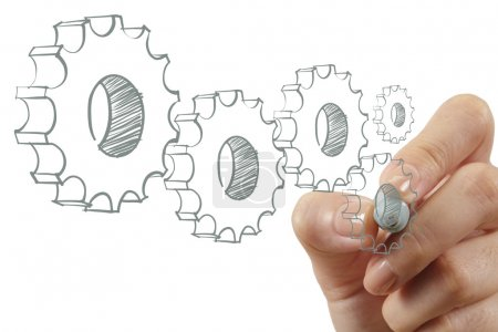 female hand draws gear to success
