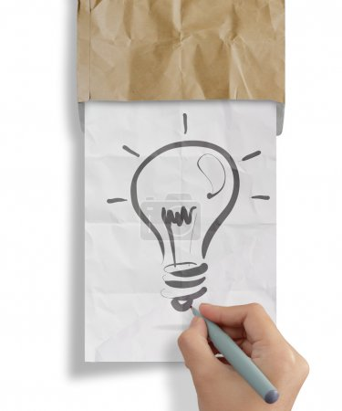 hand draws light bulb crumpled paperfrom recycle envelope