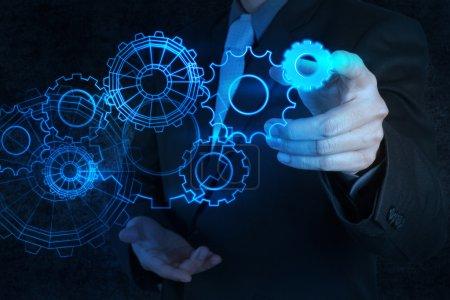 Photo pour Homme d'affaires main toucher équipement bleu au concept de succès - image libre de droit