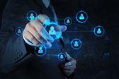 Businessman pressing modern social buttons on a virtual