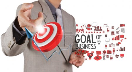 businessman hand point to goal of business as concept