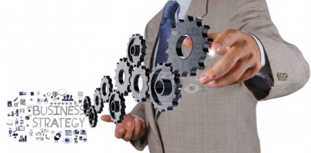 businessman hand show gear cogs and business strategy as concep