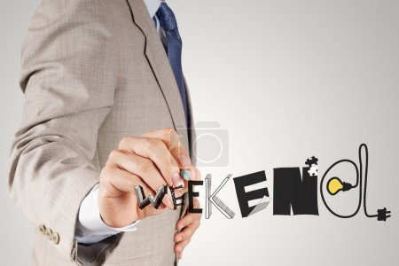 businessman hand drawing design graphic word WEEKEND as concept