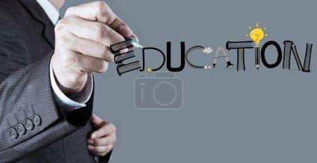 Photo pour Dessin à la main de l'entreprise conception graphique ÉDUCATION mot comme concept - image libre de droit
