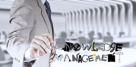 businessman hand drawing design word KNOWLEDGE MANAGEMENT as con