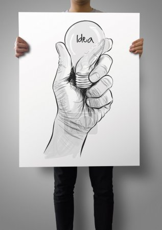 man showing poster of Hand drawn light bulb with IDEA word on cr