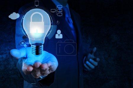 businessman hand show 3d light bulb  icon with padlock as Intern